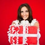 Woman holding big Christmas present — Stock Photo