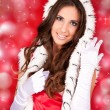Sexy santa woman on shiny background — Stock Photo #4131941