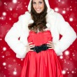 Woman in santa costume and white furry hat — Stock Photo #4132061
