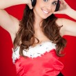 Stock Photo: Happy santa girl with headphones