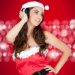 Happy santa girl with headphones — Stock Photo