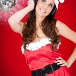 Party santa girl and shiny disco ball — Stock Photo