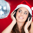 Christmas girl with disco ball — Stockfoto