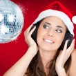 Christmas girl with disco ball - Stock Photo