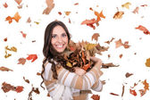 Happy girl with falling leaves — Stok fotoğraf