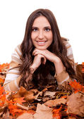 Autumn woman covered with mapple leaves — Stock Photo