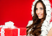 Closeup of a woman holding xmas present — Stock Photo