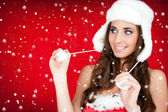 Snow and santa woman in white furry hat — Stock Photo