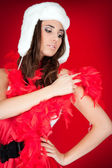Furry hat and red feather on xmas girl — Stock Photo
