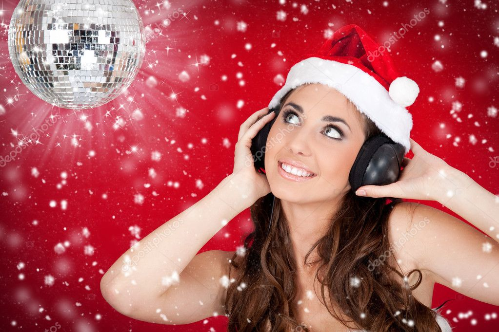Christmas girl with disco ball listening music while snowing  Stock Photo #4132226