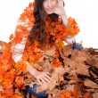 Beautiful autumn girl covered with leaves — Stock Photo