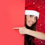 Santa girl in snow with blank billboard — Stock Photo