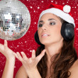 Party in snow, disco ball and girl with santa hat — ストック写真
