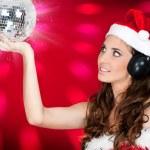 Sexy girl with santa hat and shiny disco ball — Stock Photo