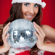 Girl with santa hat and disco ball — Stock Photo