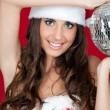 Woman with santa hat and disco ball — Stock Photo #4267708