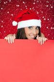 Santa girl and blank billboard — Stock Photo