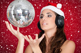 Party in snow, disco ball and girl with santa hat — Stock Photo