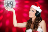 Sexy girl with santa hat and shiny disco ball — Stock Photo