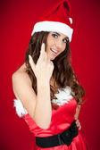 Girl with santa hat inviting — Stock Photo