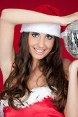Woman with santa hat and disco ball — Stock Photo