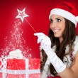Santa girl, present, magic, red — Stock Photo