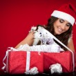 Santa girl, presents, wrapping, ribbon — Stock Photo #4458379