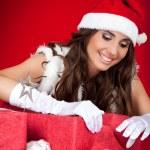 Santa girl wrapping xmas present — Stock Photo