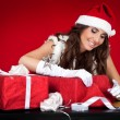 Sexy santas helper wrapping Christmas presents — Stock Photo #4458481