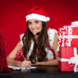 Santa girl, wishes, christmas presents — Stock Photo