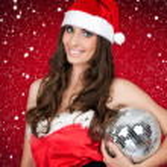 Woman in santa costume holding disco ball — Stock Photo