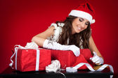 Sexy santas helper wrapping Christmas presents — Stock Photo