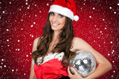 Woman in santa costume holding disco ball — Stock Photo