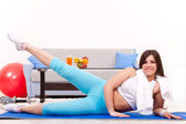 Pushing legs up, fitness at home — Stock Photo
