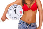 Sexy woman with clock — Stock Photo