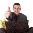 Businessman with a thumb up - Stock Photo