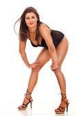 Kvinna i svarta underkläder och höga klackar — Stockfoto