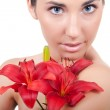 Woman with flower lily — Stock Photo