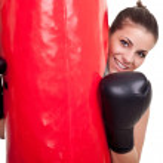Female boxer holding punching bag — Stock Photo #5205295