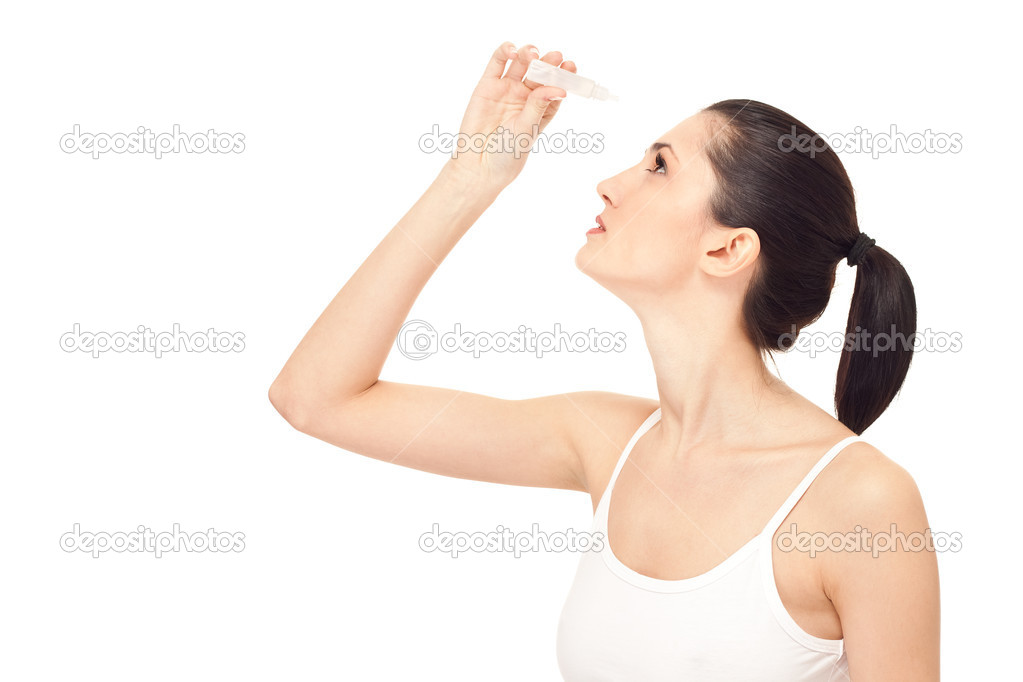 Woman dripping eye with eyes drops, isolated on white, close up — Stock Photo #5203586