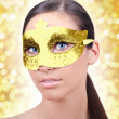 Girl with carnival gold mask - Stok fotoğraf