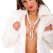 Naked woman wearing pearl necklace — Stock Photo