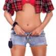 Woman takes off denim shorts — Stock Photo #5253308