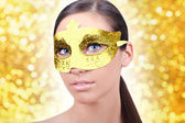 Girl with carnival gold mask — Stock Photo