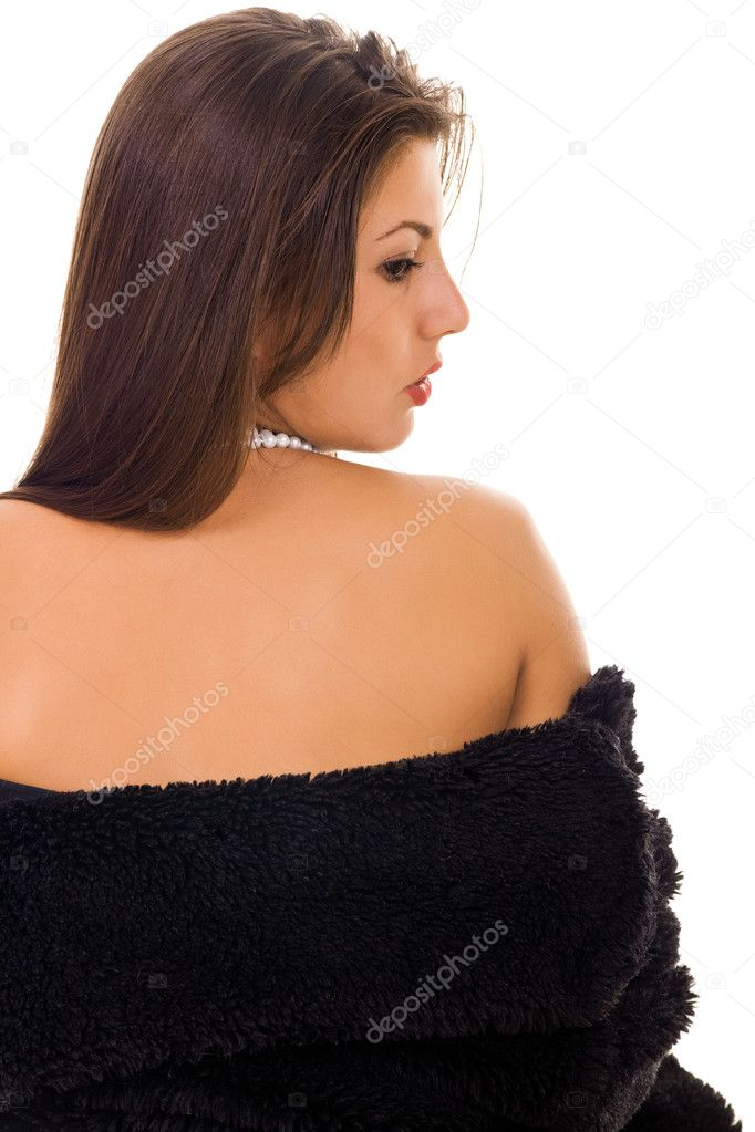 Beautiful woman with fur coat on white background and naked shoulder — Stock Photo #5253121