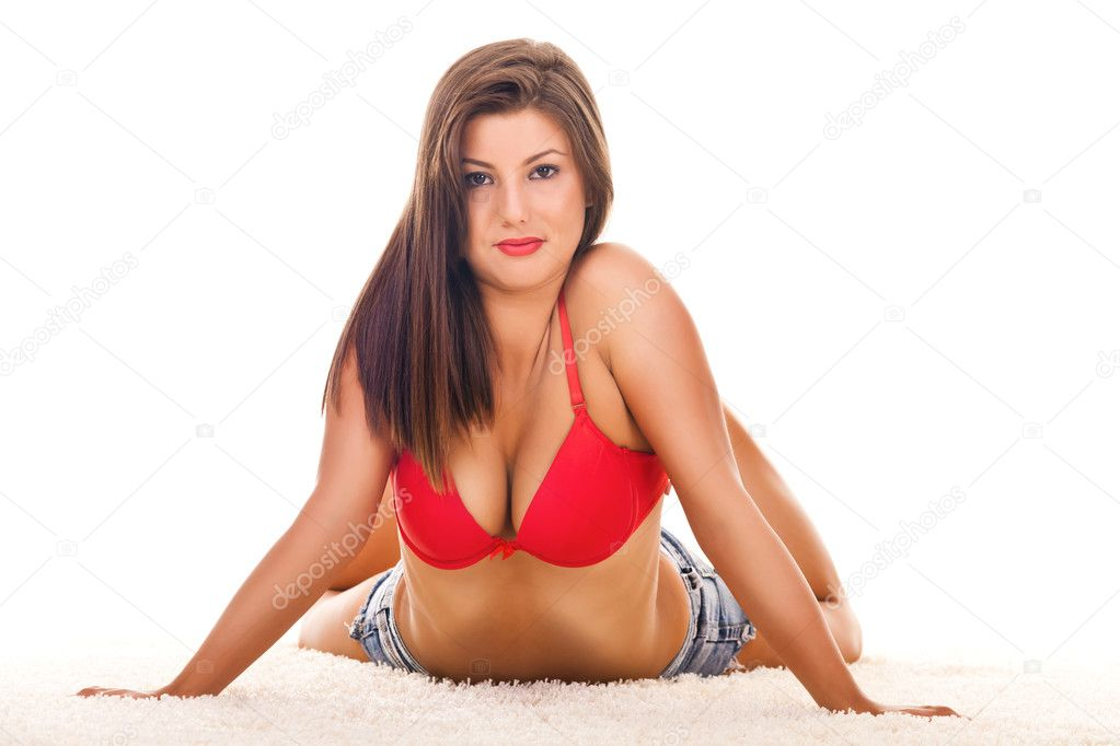 Beautiful girl in provocative sexy pose on floor