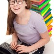 Girl with color books and laptop — Stock Photo