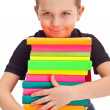 Pupil with huge pile of books — Stock Photo