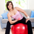 Woman doing exercise on fit ball — Stock Photo