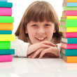 Girl between two piles of books — Stock Photo